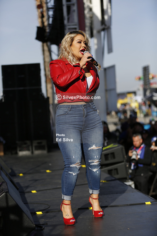 FONTANA, CA - MARCH 18  Singer Chiquis Rivera Performs live on stage prior to the Monster Energy Cup Series NASCAR Auto Club 400 race. 2018  March 18.  Byline, credit, TV usage, web usage or link back must read SILVEXPHOTO.COM. Failure to byline correctly will incur double the agreed fee. Tel: +1 714 504 6870.