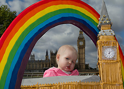 © Licensed to London News Pictures. 27/09/2012. LONDON, UK. Two and a half year old Francesca Dale, of Caterham, Surrey, is seen with a cake of the Big Ben clock tower in London today (27/09/12);  Francesca supported by the Rainbow Trust, is currently undergoing treatment for a cancerous tumour on her face. The cake, thought to be the largest of London's landmark clock tower, was made for the annual 'Big Hour Cake Sale' taking place in Canary Wharf from the 22nd to the 28th of October in aid of the Rainbow Trust, a charity that helps support families of children with life threatening or terminal illness. Photo credit: Matt Cetti-Roberts/LNP