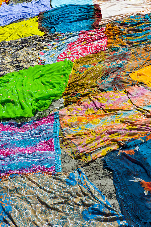 Saris and other laundry drying on the banks of River Yamuna at Agra, India