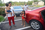 Liam Diaz, 1, is held by his father Rubin Diaz of Philadephia after Liam and his sister Ashanti Diaz (right), 6, were released from from the hospital after a tent collapsed on them at Dolphin Swim Club earlier in the day at Dolphin Swim Club Sunday, August 18, 2019 at St. Mary Medical Center in Langhorne, Pennsylvania. (Photo by William Thomas Cain / CAIN IMAGES)