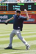 ANAHEIM, CA - JUNE 05:  Pitcher Boone Logan #48 of the New York Yankees plays catch while warming up before the game against the Los Angeles Angels of Anaheim on June 5, 2011 at Angel Stadium in Anaheim, California. The Yankees won the game 5-3. (Photo by Paul Spinelli/MLB Photos via Getty Images) *** Local Caption *** Boone Logan