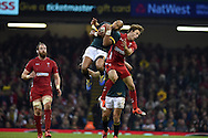 Liam Williams of Wales jumps for a high ball with South Africa's Cornal Hendricks. Dove Men series 2014, autumn international rugby match, Wales v South Africa at the Millennium stadium in Cardiff, South Wales on Saturday 29th November 2014<br /> pic by Andrew Orchard, Andrew Orchard sports photography.