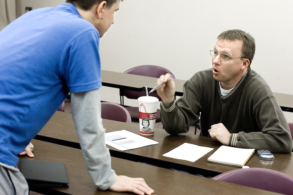 Paul Heidemann (left) gets advice from Director Dan West of the O.U. Forensics Team after presenting one of his speeches to West during a team practice on 2/13/07.