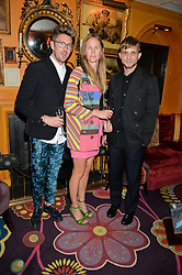 Left to right, HENRY HOLLAND, FRANCIS UPRITCHARD and CHRISTOPHER DE VOS at an exclusive dinner for Iris Apfel held at Annabel's, Berkeley Square, London on 29th July 2015.