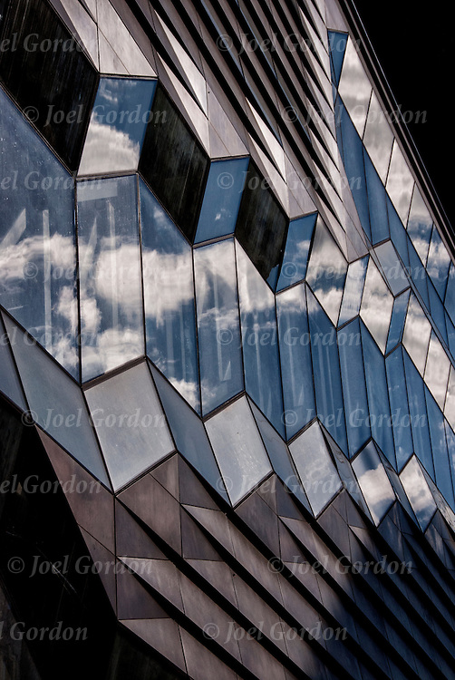 Close up of geometrical architectural design of repeating glass and metal elements on exterior of New School building on 14th Street and 5th Avenue in NYC.