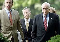 April 13, 2018 - FILE - President Trump pardoned Lewis 'Scooter' Libby, the former chief of staff to Vice President Cheney who was convicted in 2005 of perjury and obstruction of justice after a leak that disclosed a CIA agent's name. Pictured: July 1, 2005 - Washington, D.C., U.S. - DAN BARTLETT, SCOOTER LIBBY (Center), and Vice President DICK CHENEY listen to the President speak in the announced retirement of Supreme Court Justice Sandra Day O'Connor in the Rose Garden of the White House in Washington. (Credit Image: © Chuck Kennedy/TNS/ZUMAPRESS.com)