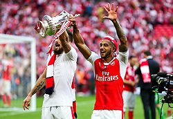 Olivier Giroud and Theo Walcott celebrate after Arsenal win the match 2-0 to become FA Cup Winners - Rogan Thomson/JMP - 27/05/2017 - FOOTBALL - Wembley Stadium - London, England - Arsenal v Chelsea - FA Cup Final.