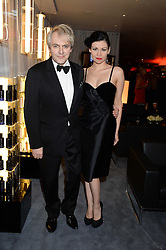 NICK RHODES and NEFER SUVIO at the GQ Men of The Year Awards 2013 in association with Hugo Boss held at the Royal Opera House, London on 3rd September 2013.