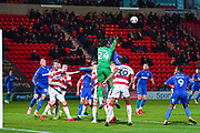 Doncaster Rovers goalkeeper Seny Dieng (24) punches clear during the The FA Cup match between Doncaster Rovers and AFC Wimbledon at the Keepmoat Stadium, Doncaster, England on 19 November 2019.