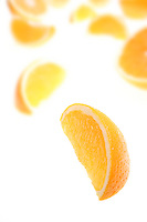 Close up of oranges on white background