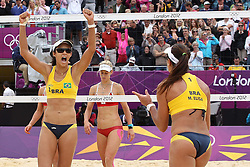 Maria Antonelli and Talita Rocha of Brazil celebrate beating Laura Ludwig and Sara Gollernof Germany during the Women's Beach Volleyball Preliminary Phase Pool E match between Brazil and Germany held at the Horse Guards Parade stadium in London as part of the London 2012 Olympics on the 31st July 2012.Photo by Ron Gaunt/SPORTZPICS