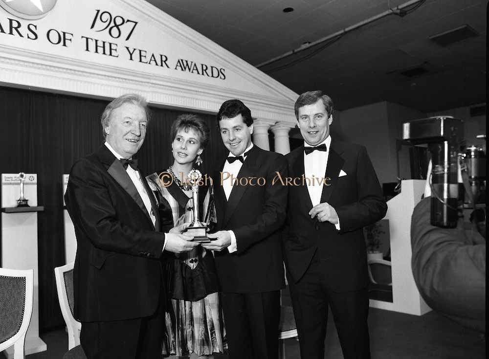 30th Texaco Sportstars of The Year.  (R71)..1988..13.01.1988..01.13.1988..13th January 1988..The Annual Texaco Sportstars awards were held in The Burlington Hotel this evening.The awards were presented by An Taoiseach, Charles Haughey TD..The list of award winners was:.Athletics.           Frank O'Meara..Cycling.             Stephen Roche..Equestrian.        Comdt gerry Mullins..Gaelic football.  Brian Stafford..Golf.                  Eamon Darcy..Horse racing.     Pat Eddery..Hurling.             Joe Cooney..Rugby.               Hugo McNeill..Snooker.            Denis Taylor..Soccer.               Liam Brady..Hall of Fame.      Danny Blanchflower.  (Soccer)...Picture shows An Taoiseach, Charles Haughey TD, presenting the award to Stephen Roche. Included in the picture are Lydia Roche (wife) and Mr Owen Jenkins, Managing Director, Texaco Ireland.