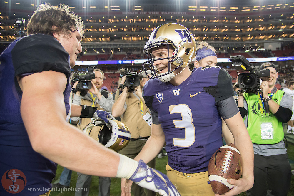 December 2, 2016; Santa Clara, CA, USA; Washington Huskies quarterback Jake Browning (3) celebrates with tight end Drew Sample (88) after the Pac-12 championship against the Colorado Buffaloes at Levi's Stadium. The Huskies defeated the Buffaloes 41-10.
