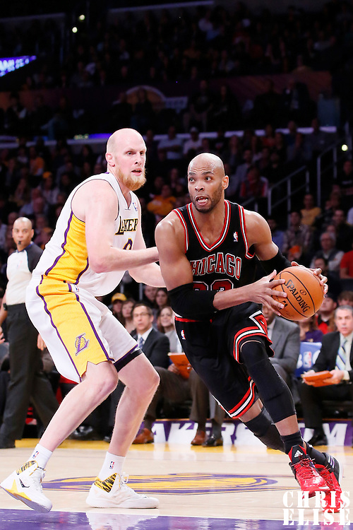 09 February 2014: Chicago Bulls power forward Taj Gibson (22) drives past Los Angeles Lakers center Chris Kaman (9) during the Chicago Bulls 92-86 victory over the Los Angeles Lakers at the Staples Center, Los Angeles, California, USA.