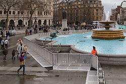 London, December 31 2017. Police in high visibility jackets and numerous anti-terrorism and crowd control measures are in place in the capital ahead of the New Year's Eve fireworks and revelry in central London. PICTURED: Security barriers have been erected around the fountains in Trafalgar Square. © SWNS