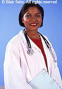 Doctor, Physician at Work, Happy Female African American Doctor, Portrait