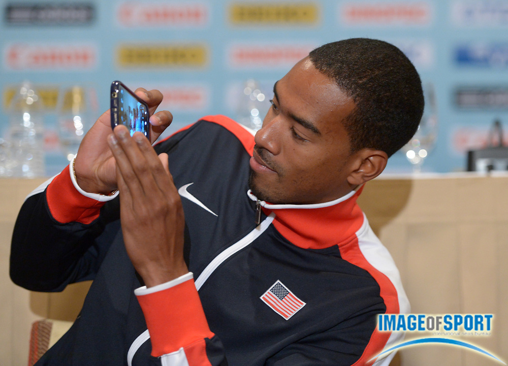 May 23, 2014; Nassau, BAHAMAS; Christian Taylor (USA) takes photos with a cell phone at press conference in advance of the IAAF World Relays at the Melia Nassau Beach Resort.  Copyright: USATF