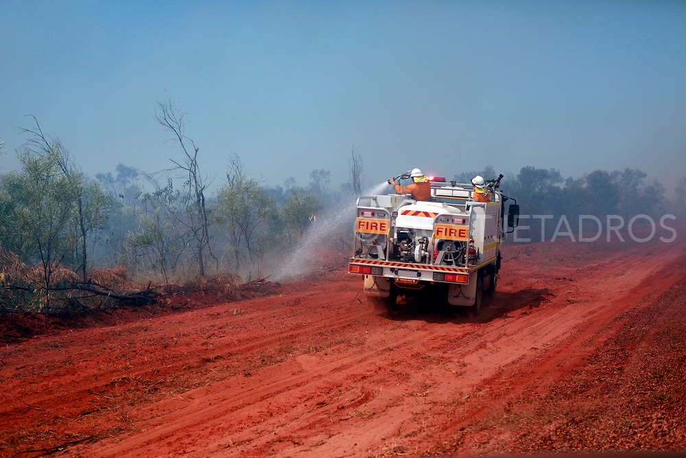 A lone fire truck wets the outskirts of the bush, basically it was impossible to stop a fire this large with just one truck! The Northern part in the Kimberley in Western Australia is very dry and the only time there's rain is in 'the wet.' The wet season is from December till March. This is in Broome on the way to the Dampier Peninsula where many fantastic camping spots are and a famous area for fishing as well. It attracts tourists from all over the world and backpackers love camping 'bush', This very large fire started when some unexperienced backpackers lit a fire for cooking and a bit of wind was only needed to create this huge bushfire. This happens occasionally in The Kimberley, which is one of the last remote places in the world. WA