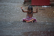 A flash storm hits Phnom Phen as a child gets caught during the Monsoon season and enjoys a flooded street.