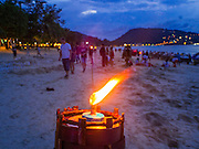 26 DECEMBER 2014 - PATONG, PHUKET, THAILAND: Tourists on the beach before the candle light service to memorialize the 2004 tsunami on Patong Beach in Patong, Phuket. Hundreds of people died in Patong and nearly 5400 people died on Thailand's Andaman during the 2004 Indian Ocean Tsunami that was spawned by an undersea earthquake off the Indonesian coast on Dec 26, 2004. In Thailand, many of the dead were tourists from Europe. More than 250,000 people were killed throughout the region, from Thailand to Kenya. There are memorial services across the Thai Andaman coast this weekend.    PHOTO BY JACK KURTZ