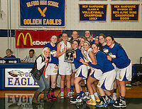 The Gilford girls basketball team with the championship win Thursday evening during the 42nd annual Holiday Basketball Tournament at Gilford High School.  (Karen Bobotas/for the Laconia Daily Sun)