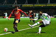 Francois Zoko (13) of Yeovil Town crosses the ball past Matteo Darmian (36) of Manchester United during the The FA Cup 4th round match between Yeovil Town and Manchester United at Huish Park, Yeovil, England on 26 January 2018. Photo by Graham Hunt.
