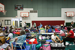 September 9, 2017 - St. Petersburg, Florida, U.S. - EVE EDELHEIT   |   Times.Evacuees settle in at the emergency shelter at John Hopkins Middle School on Saturday, September 9, 2017 in St. Petersburg. The school was beginning to fill up with people evacuating before Hurricane Irma makes landfall. The shelter welcomes people from the area with pets and those with special needs. (Credit Image: © Eve Edelheit/Tampa Bay Times via ZUMA Wire)