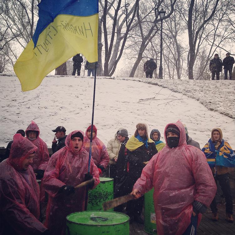Wet heavy snow brings out the latest in revolutionary fashion, Dec. 6, 2013. #kiev #київ #україна #ukraine #евромайдан #primecollective