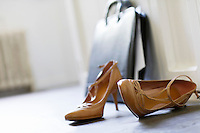 High heels and briefcase on domestic hallway floor close up
