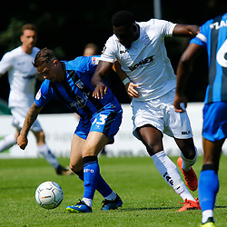 Dover's Inih Effiong is hussled from the ball by the Gillingham defence during the pre-season friendly match between Dover Athletic and Gillingham FC at Crabble Stadium, Kent on 21 July 2018. Photo by Matt Bristow.
