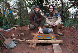 © Licensed to London News Pictures.  18/02/2015. Bristol, UK.  Richard and Danny by the entrance to a protest tunnel at the Bristol Metrobus protest.  Protesters have dug tunnels as well as tree houses to block the proposed Bristol Metrobus junction off the M32 which will remove trees and allotments on prime agricultural land known as the 'blue finger'.  Protesters in the tunnels are called badgers and those in the trees are called squirrels.  Bristol City Council has obtained a possession order but as yet the bailiffs have not evicted the campaigners.  Photo credit : Simon Chapman/LNP