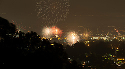 Unauthorized fireworks explode over the Laurel district of Oakland, Calif., as residents celebrate the 242nd anniversary of American independence, Wednesday, July 4, 2018. (Photo by D. Ross Cameron)