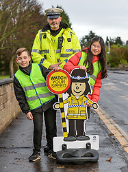 Police Scotland Traffic Officer Seb Milne with 11 year olds Jack Wilson and Juha Lee with the 'pop up' school kids who will be positioned outside schools across the country as part of a new Police Scotland school road safety initiative.<br /> <br /> © Dave Johnston/ EEm