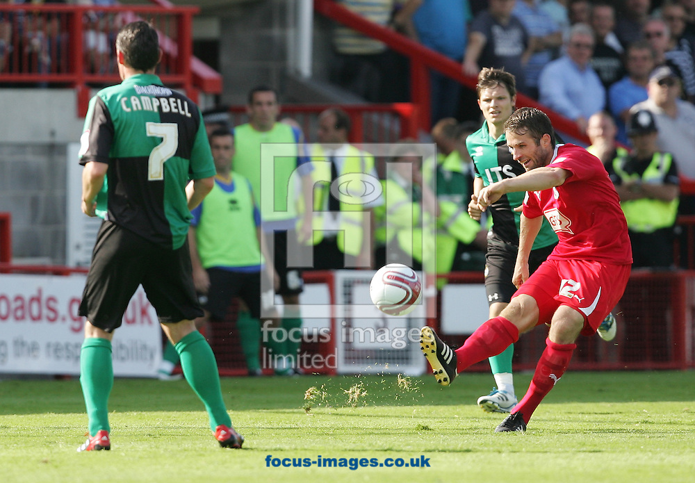 Picture by Paul Terry/Focus Images Ltd..3/9/11.Ben Smith of Crawley and Stuart Campbell of Bristol Rovers during the Npower League 2 match at The Broadfield Stadium, Crawley, West Sussex.