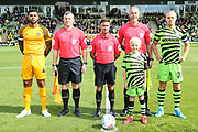 Match day mascot and captains during the EFL Sky Bet League 2 match between Forest Green Rovers and Newport County at the New Lawn, Forest Green, United Kingdom on 31 August 2019.
