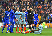 Cardiff City players looked shocked as referee Craig Pawson only shows a yellow card to Antonio Rudiger (2) of Chelsea after he deliberately brought down Kenneth Zohore (10) of Cardiff City who had a clear goal scoring chance which Cardiff players believed should have been a red card for the Chelsea player during the Premier League match between Cardiff City and Chelsea at the Cardiff City Stadium, Cardiff, Wales on 31 March 2019.