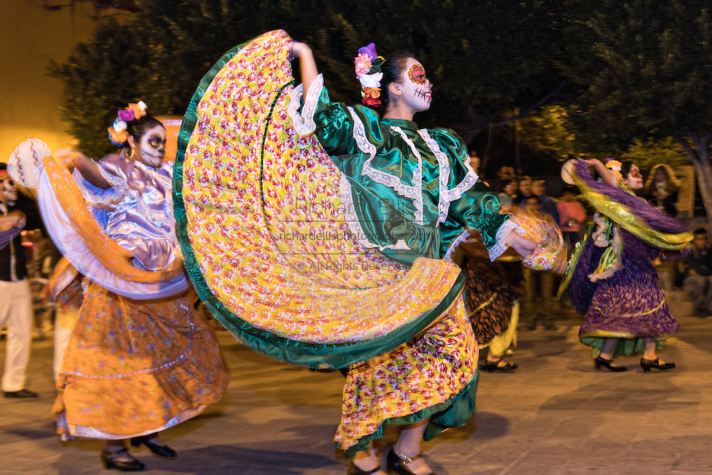 Young women dressed as skeletons perform traditional dances during the Day of the Dead festival in the Plaza Civica October 28, 2016 in San Miguel de Allende, Guanajuato, Mexico. The week-long celebration is a time when Mexicans welcome the dead back to earth for a visit and celebrate life.