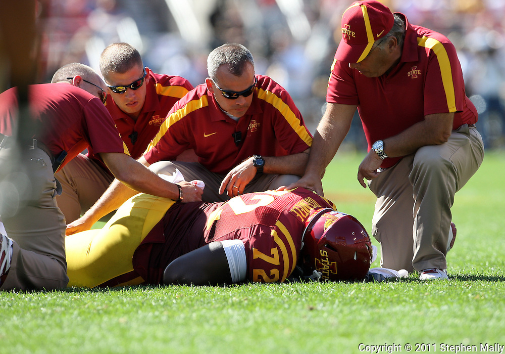 September 10, 2011: Iowa State Cyclones offensive linesman Kelechi Osemele (72) is assisted by trainers during the first half of the game between the Iowa Hawkeyes and the Iowa State Cyclones during the Iowa Corn Growers Cy-Hawk game at Jack Trice Stadium in Ames, Iowa on Saturday, September 10, 2011. Iowa State defeated Iowa 44-41 in 3OT.