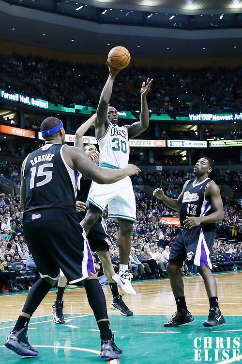 30 January 2013: Boston Celtics power forward Brandon Bass (30) passes the ball during the Boston Celtics 99-81 victory over the Sacramento Kings at the TD Garden, Boston, Massachusetts, USA.