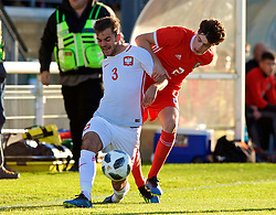 BANGOR, WALES - Monday, October 15, 2018: Wales' Neco Williams (R) tackles Poland's Marcin Grabowski (L) during the UEFA Under-19 International Friendly match between Wales and Poland at the VSM Bangor Stadium. (Pic by Paul Greenwood/Propaganda)