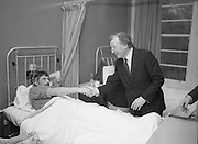 Image of Fianna Fáil leader Charles Haughey touring West Cork during his 1982 election campaign...04/02/1982.02/04/82.4th February 1982..Reaching Out:..Mr Haughey greets a patient in Clonakilty County Hospital.