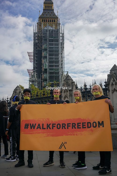 London, UK. 14th October, 2017. The A21 hosted Walk For Freedom on October 14, 2017 fight together as a global community to illuminate the darkness of human trafficking, and raise funds to rescue and restore more lives than ever before. In over 600 locations around the world, we will lace up our shoes, put yellow tape around our mouths, and march in single-file to eradicate modern-day slavery for GOOD!
