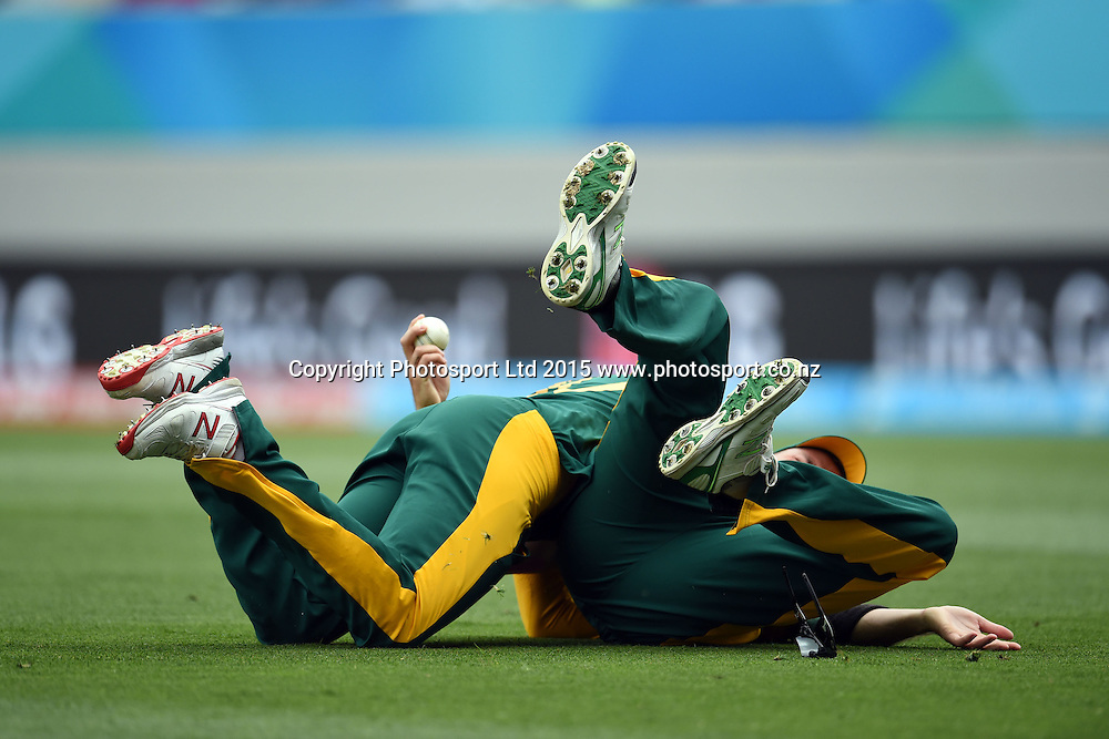 South African fielders Dale Steyn and Rilee Rossouw celebrate the catch of Ahmad Shahzad during the ICC Cricket World Cup match between Pakistan and South Africa at Eden Park in Auckland, New Zealand. Saturday 07 March 2015. Copyright Photo: Raghavan Venugopal / www.photosport.co.nz