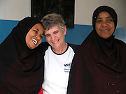 VSO volunteer teacher trainer, Daphne Sharp. Pictured here alongside teacher Asya Hassan Mussa and the head teacher of Saateni nursery school, Zanzibar, Tanzania. Daphne has now trained over 100 nusery school teachers and 18 heads of pre school.