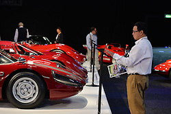 © Licensed to London News Pictures. 08/09/2013. London, England. RM Auctions Classic Car auction at Battersea Evolution, London. Photo credit : Mike King/LNP. RM Auctions 8-9 September 2013 at Battersea Evolution. A man views a Porsche 904/6.