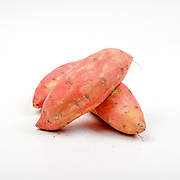 Fresh and organic Sweet potato  on white background