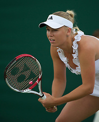 LONDON, ENGLAND - Friday, June 24, 2011: Caroline Wozniacki (DEN) in action during the Ladies' Singles 2nd Round match on day five of the Wimbledon Lawn Tennis Championships at the All England Lawn Tennis and Croquet Club. (Pic by David Rawcliffe/Propaganda)