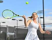 LAS VEGAS, NV - JANUARY 20:  Quinty Janssen of the New Mexico State Aggies plays a forehand during her team's doubles match against McKenna Lloyd and Sara Parker of the Weber State Wildcats at the Frank and Vicki Fertitta Tennis Complex in Las Vegas, Nevada. New Mexico State won the doubles match 6-3.