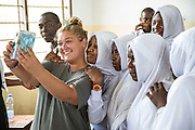 At the end of the final class Charlotte Clough poses for a selfie with students she has been working with for 6 weeks at Angaza school. Part of the VSO / ICS Elimu Fursa project (Opportunities in Education) Lindi, Lindi region. Tanzania.