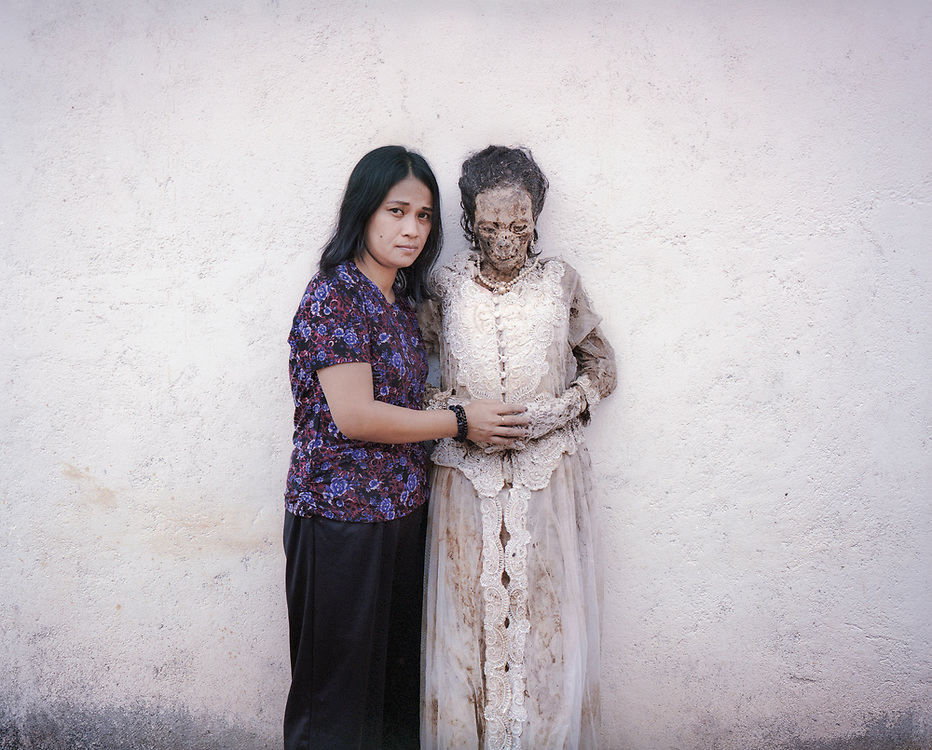Abigael Randa (37) and her mother, Lince Bunga, who died in 2015 at age 58. This is the first time Lince's body was taken out since her death.  It is customary not to visibly cry during Ma'nene and Abigael went to the back to shed tears. <br />